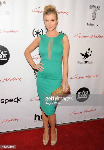 Actress Joanna Krupa arrives at the screening of Roadside Attractions Day 28 Films Gimme Shelter at the Egyptian Theatre on January 14 2014 in...