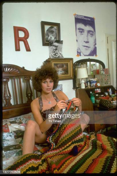 Actress Joanna Lumley, known for her role as Purdey in action series The New Avengers, photographed knitting at home, circa 1976.