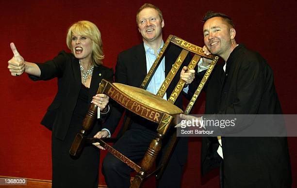 Actress Joanna Lumley Miles Apthorp and actor Rory Bremner pose with the JK Rowling 'Harry Potter' chair at the Chairish the Child celebrity auction...
