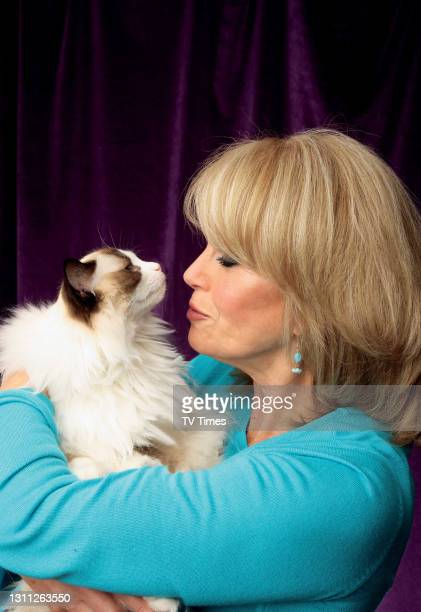 Joanna Lumley posed with cat on September 5, 2009.