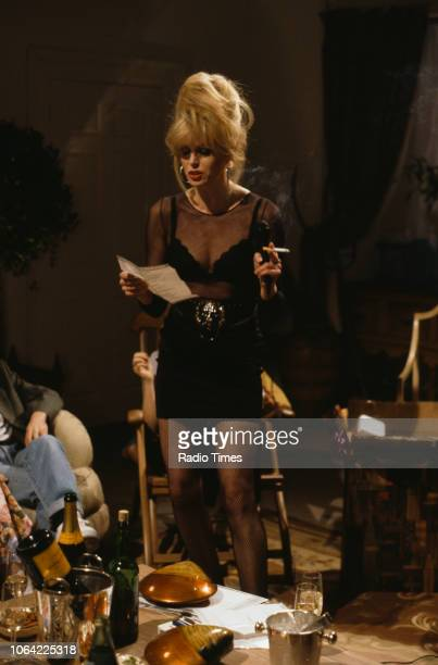 Actress Joanna Lumley singing karaoke in a scene from episode 'Birthday' of the television sitcom 'Absolutely Fabulous', March 10th 1992.