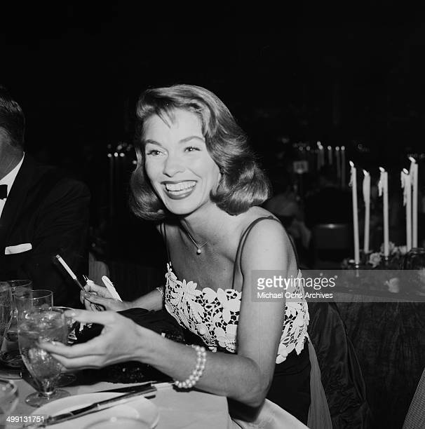 Actress Joanne Dru attends a Stanley Kramer dinner party in Los Angeles California