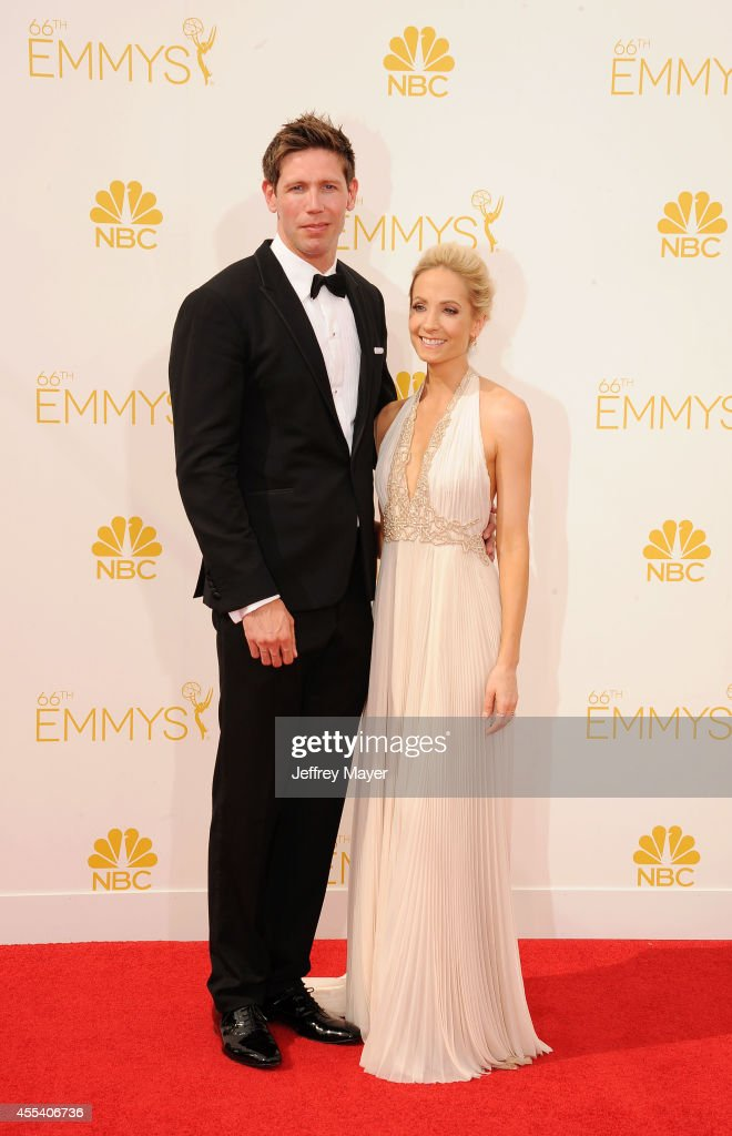 Actress Joanne Froggatt (R) and James Cannon arrive at the 66th Annual Primetime Emmy Awards at Nokia Theatre L.A. Live on August 25, 2014 in Los Angeles, California.
