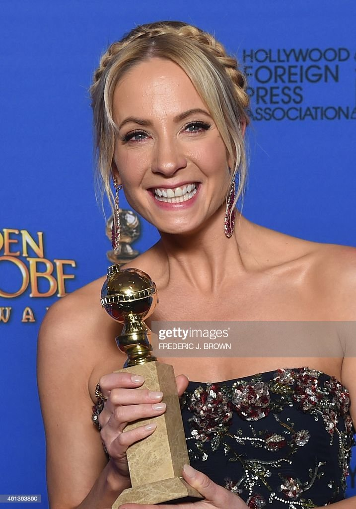 Actress Joanne Froggatt holds the award for Best Supporting Actress - Series/Mini-Series/TV Movie 'Downtown Abbey', in the press room at the 72nd annual Golden Globe Awards, January 11, 2015 at the Beverly Hilton Hotel in Beverly Hills, California.