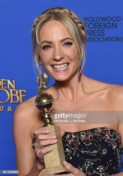 Actress Joanne Froggatt holds the award for Best Supporting Actress Series/MiniSeries/TV Movie 'Downtown Abbey' in the press room at the 72nd annual...