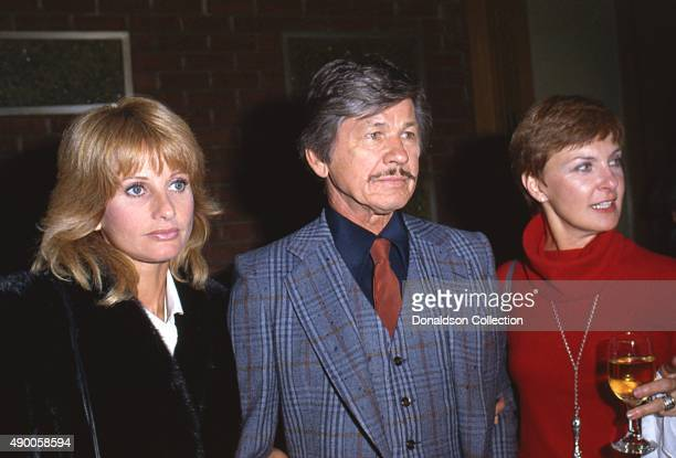 Actress Joanne Woodward attends an event with Charles Bronson and Jill Ireland in December 1980 in Los Angeles, California.
