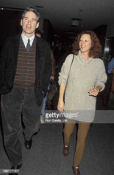 Actress JoBeth Williams and actor Kevin Klein being photographed on March 5 1993 at the Los Angeles International Airport in Los Angeles California