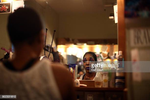 Actress Jocelyn Jee Esien checks her make up before performing as Stomach Bug in Jack and the Beanstalk at Hackney Empire on December 22 2015 in...
