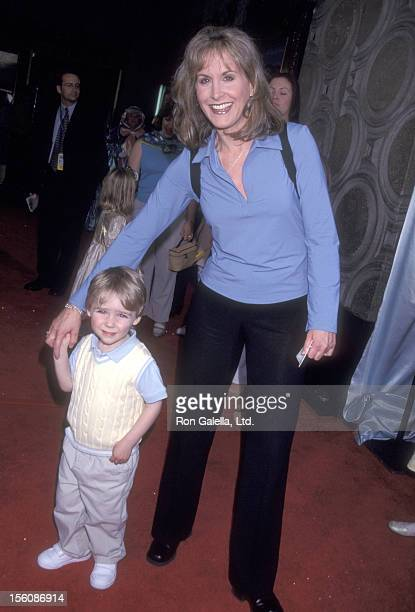 Actress Jodi Benson and son Mckinley Benson attend the 'Cinderella II Dreams Come True' Hollywood Premiere on February 23 2002 at El Captian Theatre...