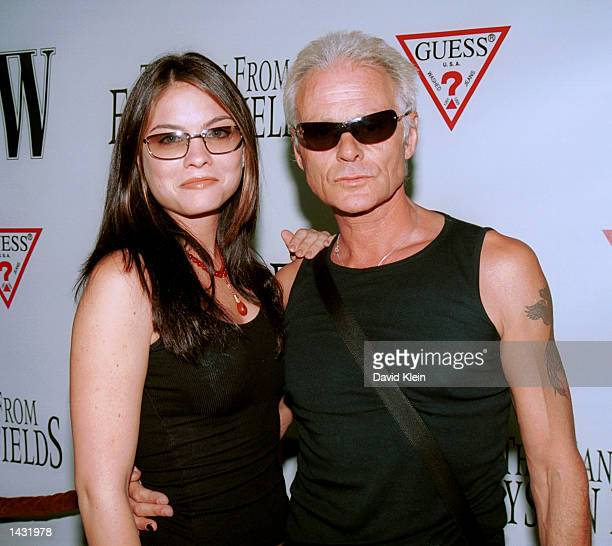 Actress Jodi Lyn O'Keefe poses with singer Michael Des Barres at the premiere of 'The Man From Elysian Fields' on September 23 2002 in Los Angeles...