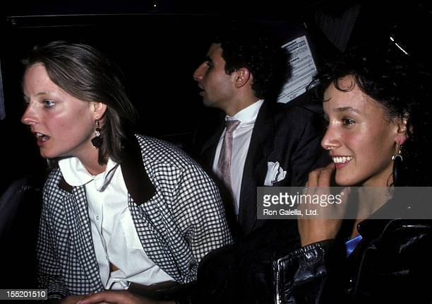 Actress Jodie Foster and friend Marco Pasanella and actress Jennifer Beals attend the 'Top Gun' Premiere Party on May 12 1986 at America in New York...