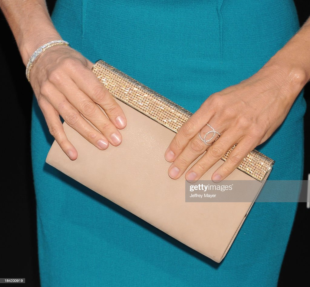 Actress Jodie Foster (handbag, bracelet ring detail) at the Los Angeles premiere of 'Elysium' at Regency Village Theatre on August 7, 2013 in Westwood, California.