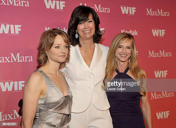Actress Jodie Foster Women In Film president Jane Fleming and actress Holly Hunter arrive at the Women In Film 2009 Crystal Lucy Awards at the Hyatt...