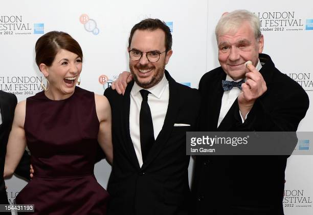Actress Jodie Whittaker and director Glenn Leyburn are shocked as actor Terri Hooley takes his eye out attend the 'Good Vibrations' premiere during...