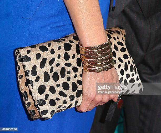 Actress Joelle Carter clutch and bracelet detail attends the premiere of FX's 'Justified' series finale at ArcLight Cinemas Cinerama Dome on April 13...