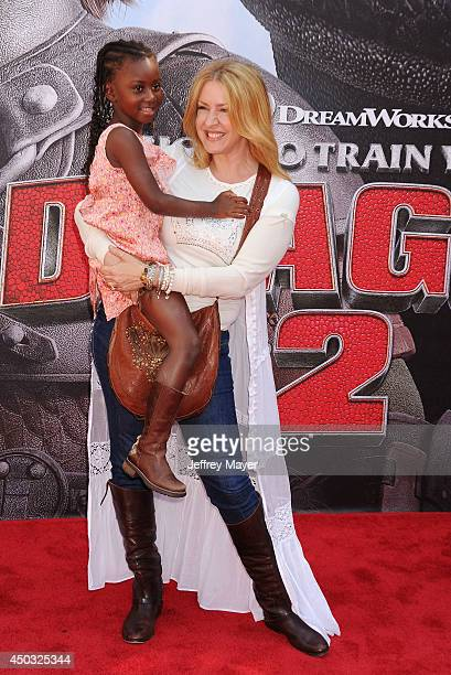 Actress Joely Fisher and daughter Olivia Luna FisherDuddy arrive at the Los Angeles premiere of 'How To Train Your Dragon 2' at the Regency Village...