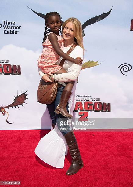 Actress Joely Fisher and her daughter Olivia Luna FisherDuddy arrive at the Los Angeles premiere of How To Train Your Dragon 2 at the Regency Village...