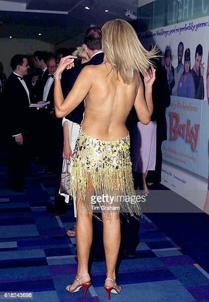 Actress Joely Richardson in revealing sexy backless fringe evening dress at movie premiere in London