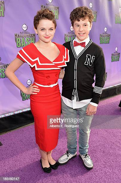 Actress Joey King and actor Nolan Gould attend the Hub Network's 1st Annual Halloween Bash at Barker Hangar on October 20 2013 in Santa Monica...