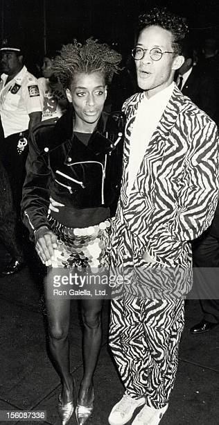 Actress Joi Lee and date attending premiere of 'Mo' Better Blues' on July 23 1990 at the Ziegfeld Theater in New York City New York