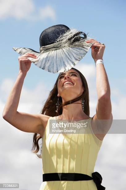 """Actress Jolene Anderson adjusts her hat at the """"Fashions on the Field"""" competition during the Cox Plate meeting at Moonee Valley Racing Club on..."""