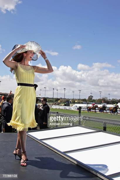 Actress Jolene Anderson watches a race during 'Fashions on the Field' competition during the Cox Plate meeting at Moonee Valley Racing Club on...