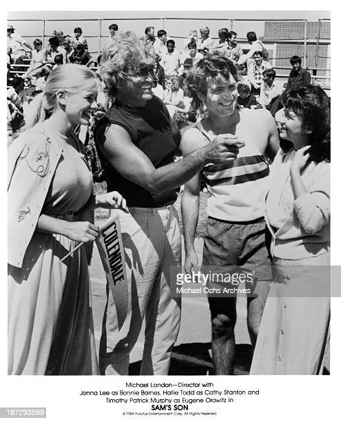 Actress Jonna Lee Director Michael Landon actor Timothy Patrick Murphy and actress Hallie Todd on set for the movieSam's Son in 1984