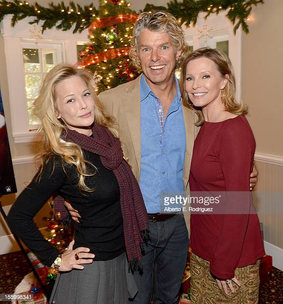 Actress Jordan Ladd writer/director Robert Vince and actress Cheryl Ladd attend the 'Santa Paws 2 The Santa Pups' holiday party hosted by Disney...
