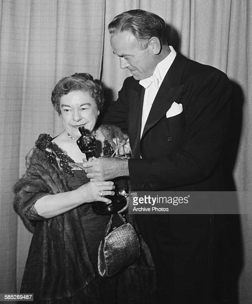 Actress Josephine Hull receiving her Best Supporting Actress Oscar from Dean Jagger for the film 'Harvey' at the 23rd Academy Awards Los Angeles...