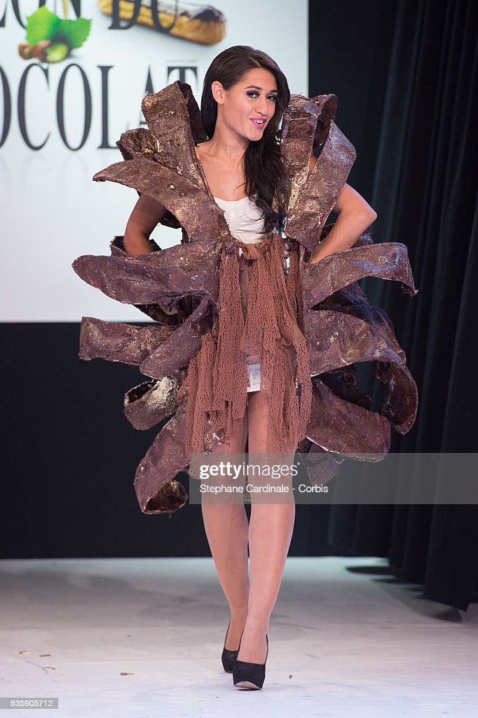 Actress Josephine Jobert walks the runway and wears 'Eclosion' a chocolate dress made by designer Stephane Martello and chocolate maker Bruno Rouly during the Fashion Chocolate Show at Salon du Chocolat at Porte de Versailles, in Paris.
