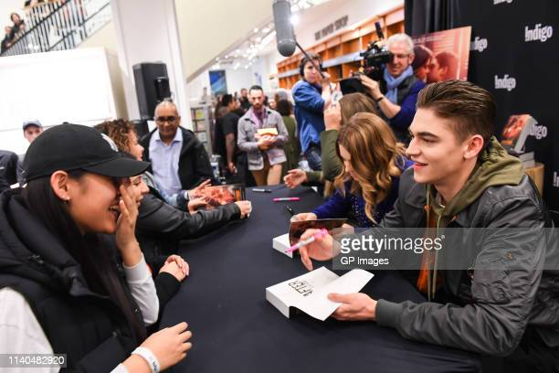 Actress Josephine Langford and actor Hero Fiennes Tiffin attend the After book signing at Indigo Yorkdale on April 04 2019 in Toronto Canada