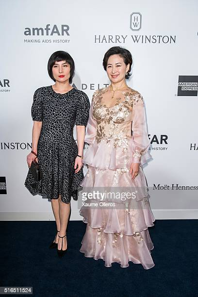Actress Josie Ho and businesswoman Pansy Ho attends the 2016 amfAR Hong Kong gala with a guest at Shaw Studios on March 19 2016 in Hong Kong Hong Kong