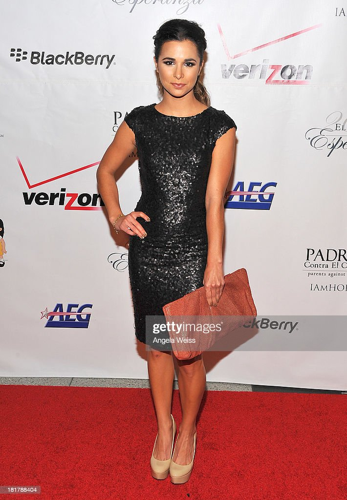Actress Josie Loren arrives at the Padres Contra El Cancer 13th annual 'El Sueno de Esperanza' gala on September 24, 2013 in Los Angeles, California.