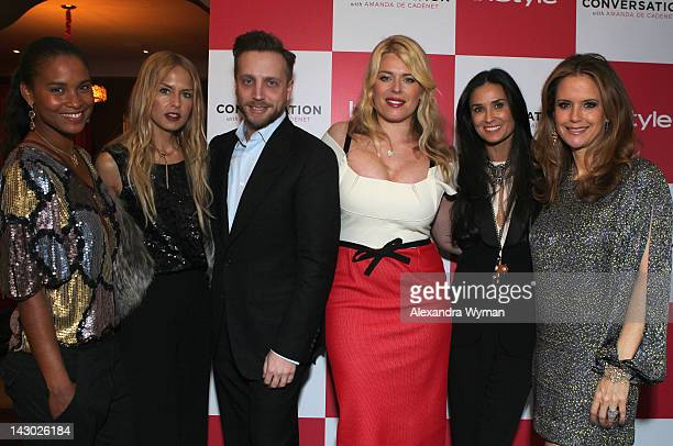 Actress Joy Bryant stylist Rachel Zoe Editor of InStyle Ariel Foxman host/photographer Amanda de Cadenet actress Demi Moore and actress Kelly Preston...