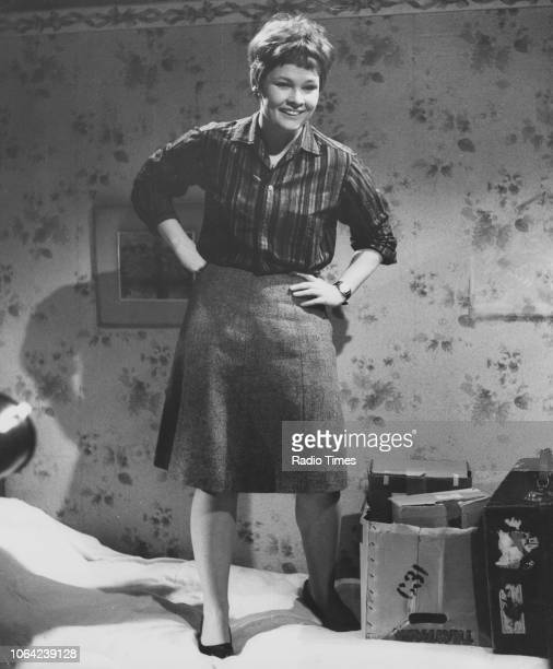 Actress Judi Dench standing on a bed in a scene from episode 'Anytime You're Ready I'll Sparkle', of the television series 'Talking to a Stranger',...