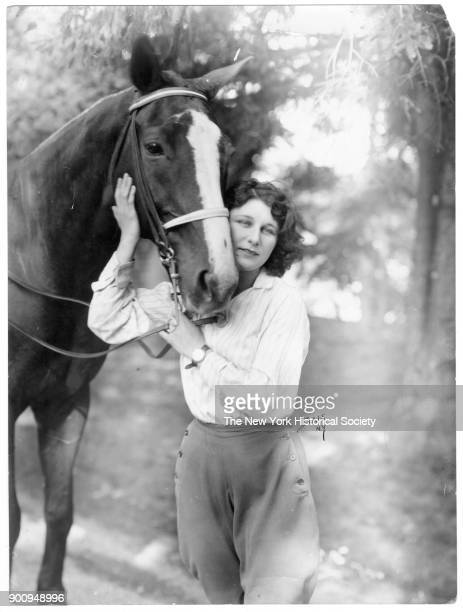 Actress Judith Anderson in breeches with horse 1921