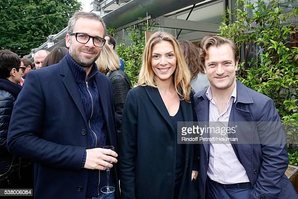 Actress Judith El Zein standing between her husband assistant director Daniel Dittmann and violonist Renaud Capucon attend Day Fourteen Women...