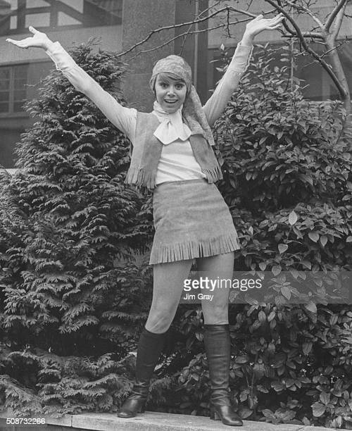 Actress Judy Carne wearing a leather fringed mini outfit as she poses outside ATV Studios during rehearsals for her show 'Sock it to Me' London March...