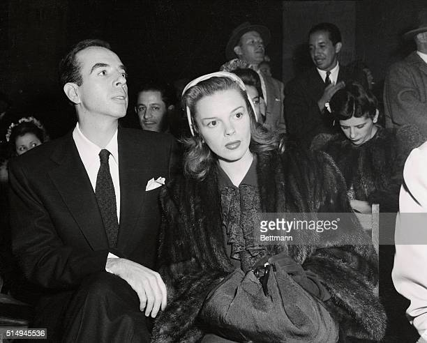 Actress Judy Garland and fiance movie director Vincente Minnelli are shown watching the homecoming show in Los Angeles Memorial Coliseum