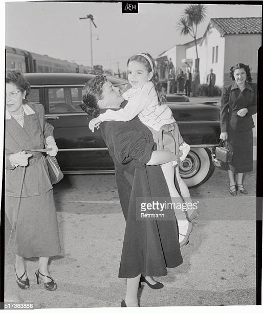 Actress Judy Garland greets her daughter Liza upon returning to Hollywood from a vacation in Florida When reporters asked the actress if she planned...