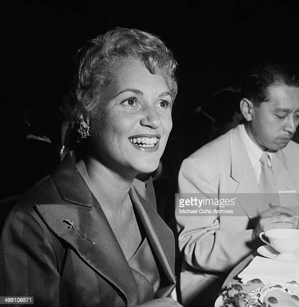 Actress Judy Holliday attends the Crown Prince party at MGM in Los AngelesCalifornia