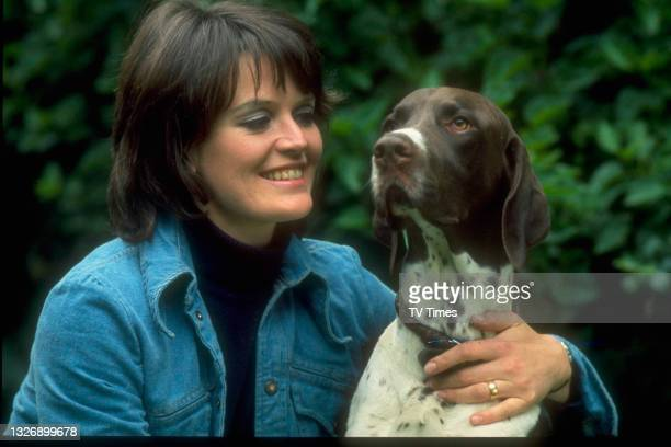 Actress Judy Loe photographed at home with her pet Spaniel, circa1975.