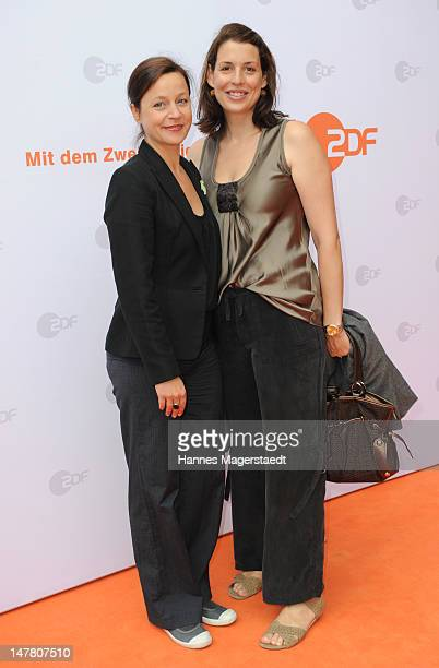 Actress Jule Ronstedt and Elena Uhlig attend the ZDF reception during the Munich Film Festival 2012 at the H'ugo's on July 3 2012 in Munich Germany