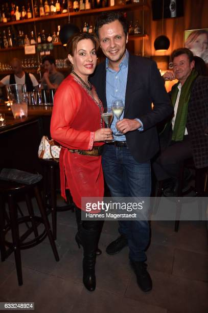 Actress Julia Dahmen and her husband Carlo Fiorito during the 'Goldene Momente' Vernissage at Bruckmann's Bar on January 31 2017 in Munich Germany