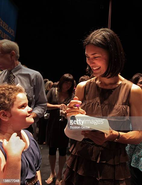 Actress Julia Jones right greeted Emily Snider of Newton as Jones met fans at the Wheelock Family Theatre on May 27 2010 Jones used to perform at the...