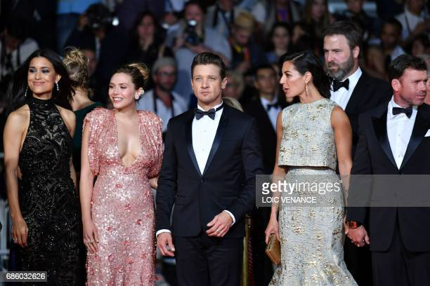 US actress Julia Jones US actress Elizabeth Olsen US actor Jeremy Renner and US director Taylor Sheridan and his wife Nicole pose as they arrive on...