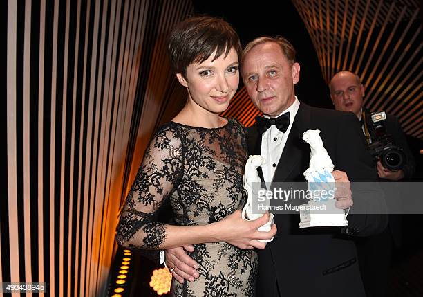 Actress Julia Koschitz and actor Alexander Held pose with the award during the 'Bayerischer Fernsehpreis 2014' at Prinzregententheater on May 23 2014...