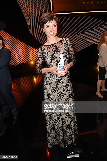 Actress Julia Koschitz poses with the award during the 'Bayerischer Fernsehpreis 2014' at Prinzregententheater on May 23 2014 in Munich Germany