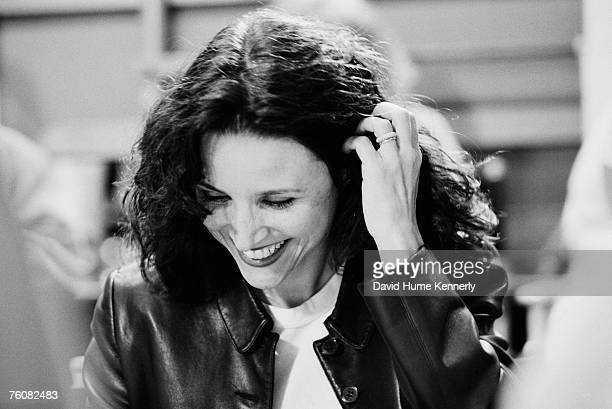 Actress Julia Louis Dreyfus smiles as she reads a script during the last days of shooting the hit tv show 'Seinfeld' April 3 1998 in Studio City...