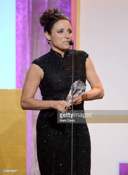 Actress Julia LouisDreyfus accepts the Best Actress in a Comedy Series award for 'Veep' onstage during Broadcast Television Journalists Association's...